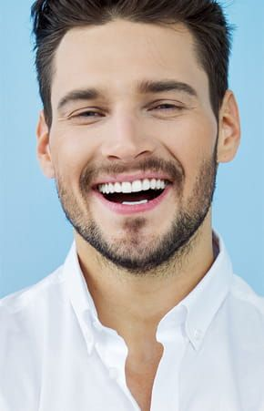 Man smiling with his newly restored smile - Restoration Dental